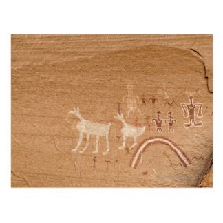 Pictographs on sandstone canyon walls in Canyon Postcard