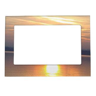 Picture frame orange sun in the lake