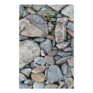 Picture of stones on a beach. flyer