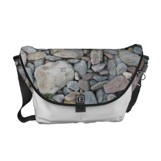 Picture of stones on a beach. messenger bags