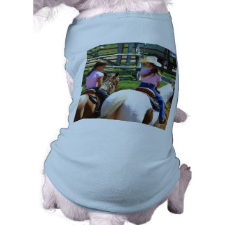 Picture Of Two Young Cowgirls Riding Their Horses Dog Clothes