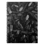 Picture of wood pieces in black and white. note book