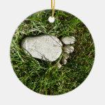 Pie de piedra ornamento de navidad