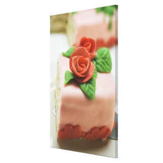 Piece of birthday cake with marzipan roses on gallery wrapped canvas