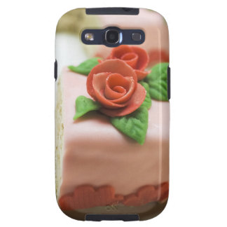 Piece of birthday cake with marzipan roses on samsung galaxy SIII cover