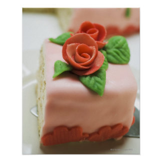 Piece of birthday cake with marzipan roses on print