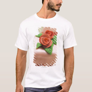 Piece of birthday cake with marzipan roses on T-Shirt