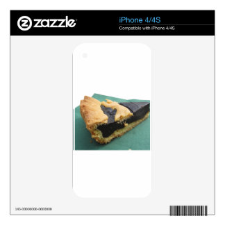 Piece of chocolate cake on green paper napkin skin for iPhone 4S