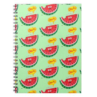 Piece of watermelon expressing pain after a bite notebook