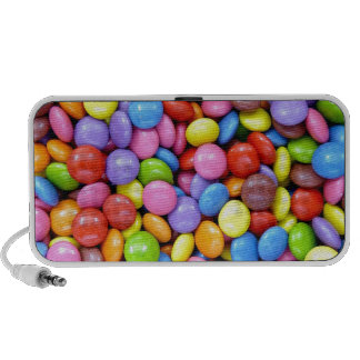 pieces of colorful candy notebook speakers