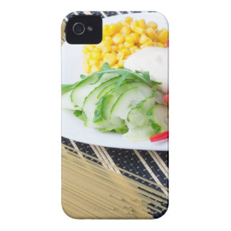Pieces of fresh raw vegetables on a white plate iPhone 4 cover