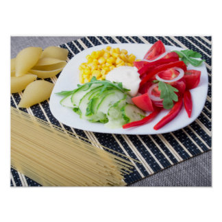 Pieces of fresh raw vegetables on a white plate poster