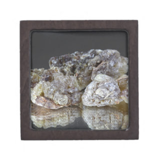 Pieces of natural frankincense resin on a mirror. gift box
