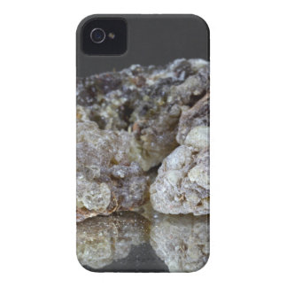 Pieces of natural frankincense resin on a mirror. iPhone 4 cases