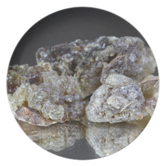 Pieces of natural frankincense resin on a mirror. melamine plate