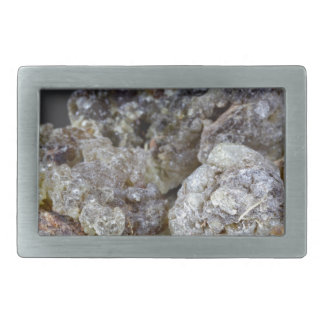 Pieces of natural frankincense resin on a mirror. rectangular belt buckle