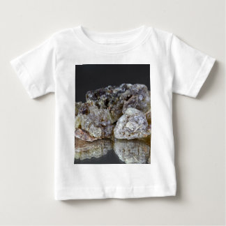 Pieces of natural frankincense resin on a mirror. t shirt