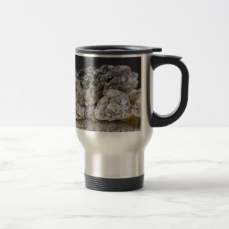 Pieces of natural frankincense resin on a mirror. travel mug