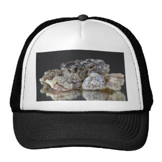 Pieces of natural frankincense resin on a mirror. trucker hat
