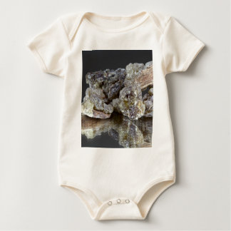 Pieces of natural frankincense romper