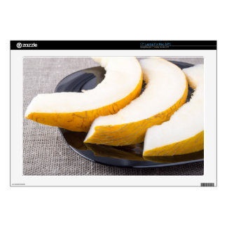 """Pieces yellow melon on a black plate 17"""" laptop decals"""