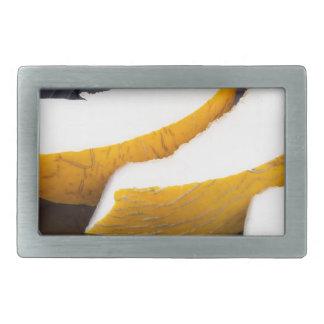 Pieces yellow melon on a black plate rectangular belt buckle