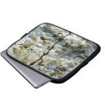 Piedra áspera con la grieta funda computadora