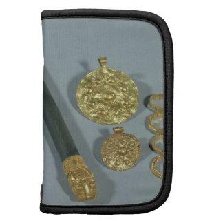 Piedra de afilar y anillos con la decoración granu planificador