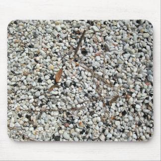Piedra del guijarro con suciedad tapete de ratones
