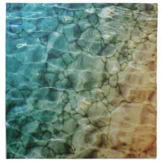Piedras en el mar servilletas imprimidas