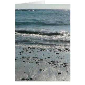 Piedras en orilla de la playa felicitación