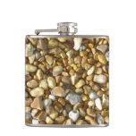 Piedras en un frasco de la playa