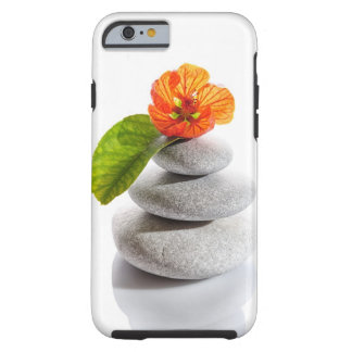 Piedras equilibradas y flor roja funda para iPhone 6 tough