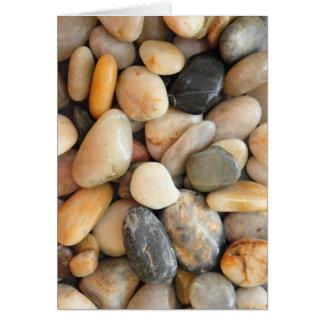 Piedras multicoloras felicitacion