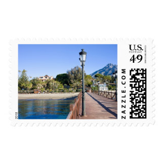 Pier and Beach in Marbella Stamp