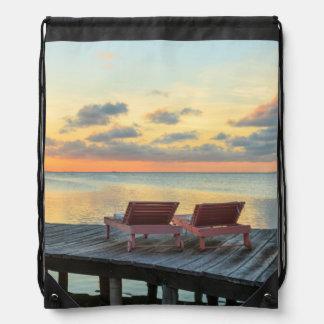 Pier overlooks the ocean, Belize Drawstring Backpack