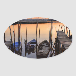 Pier stilt on the river oval sticker
