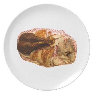 pierna y carne de pavo en el disco blanco rojo plato de cena