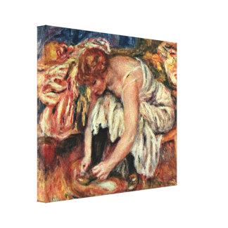 Pierre-Auguste Renoir - Woman in shoe tying Canvas Print
