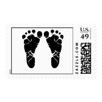 Pies del bebé estampillas