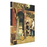 Pieter de Hooch - Men and a woman in courtyard Canvas Prints