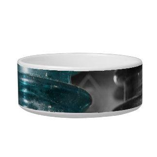 Pieza azul de la foto de los aisladores coloreada tazon para gato
