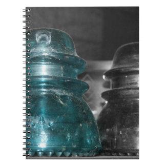 Pieza azul de la foto de los aisladores coloreada libros de apuntes con espiral
