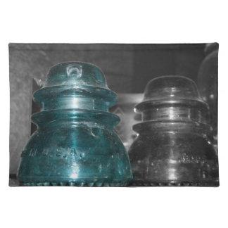 Pieza azul de la foto de los aisladores coloreada mantel individual