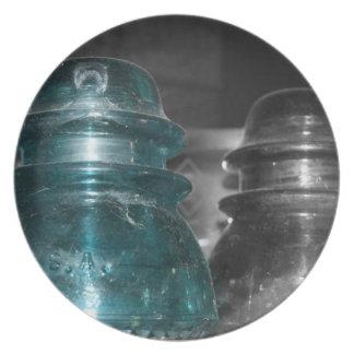 Pieza azul de la foto de los aisladores coloreada platos de comidas