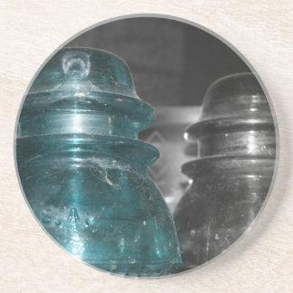 Pieza azul de la foto de los aisladores coloreada posavasos diseño