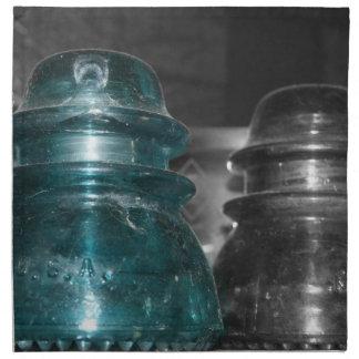 Pieza azul de la foto de los aisladores coloreada servilleta de papel