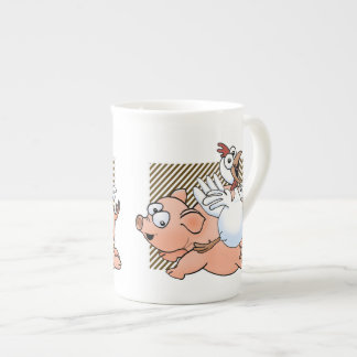 Pig and chicken jumping with joy. tea cup