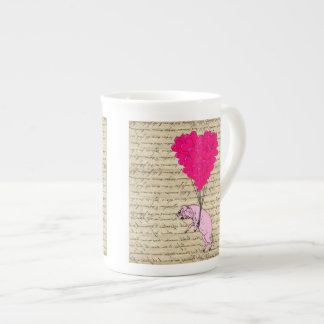Pig and heart balloons tea cup