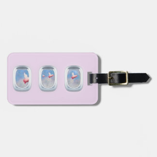 Pigs flying past airplane windows bag tag